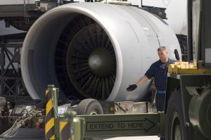 Staff Sgt. Sean Donovan directs a crane into position while preparing to mount an engine on a C-5 Galaxy on May 12, 2006, at Ramstein Air Base Germany.  Sergeant Donovan is a jet engine mechanic assigned to the 723rd Air Mobility Squadron. (U.S. Air Force photo/Master Sgt. John E. Lasky)
